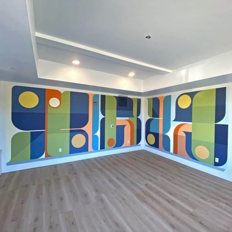 Jason T. Graves designs and paint new mural for Metro West Housing. Location is the Sage Corner equal opportunity multi family apartments.